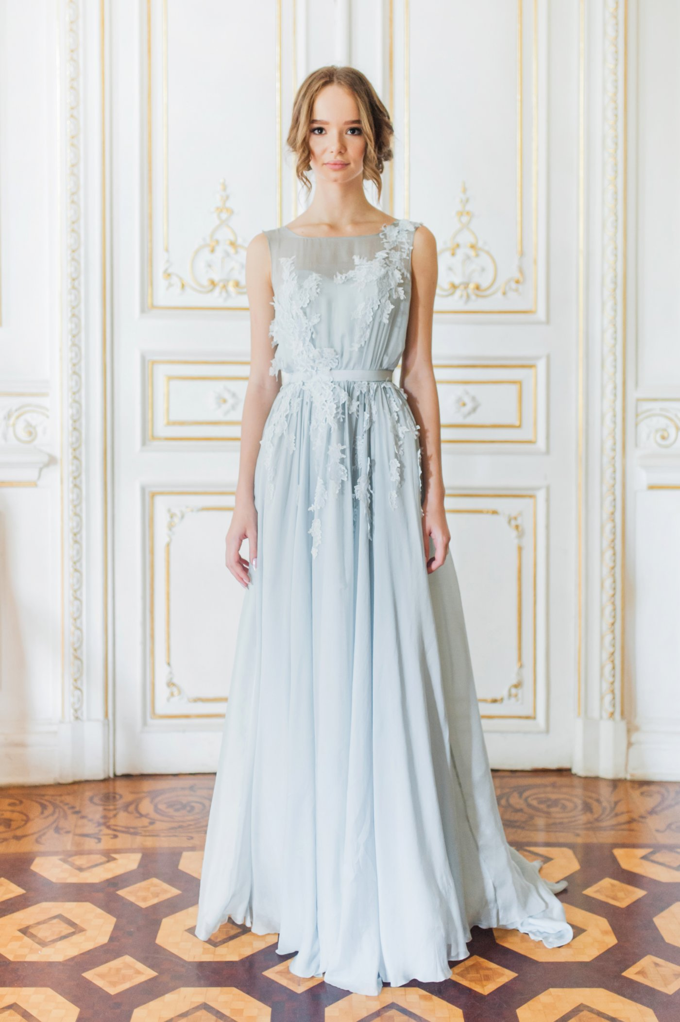Sleeveless blue wedding gown with floral lace appliques floating ...
