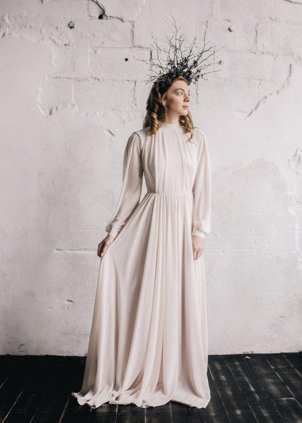 Nude bishop sleeve wedding dress