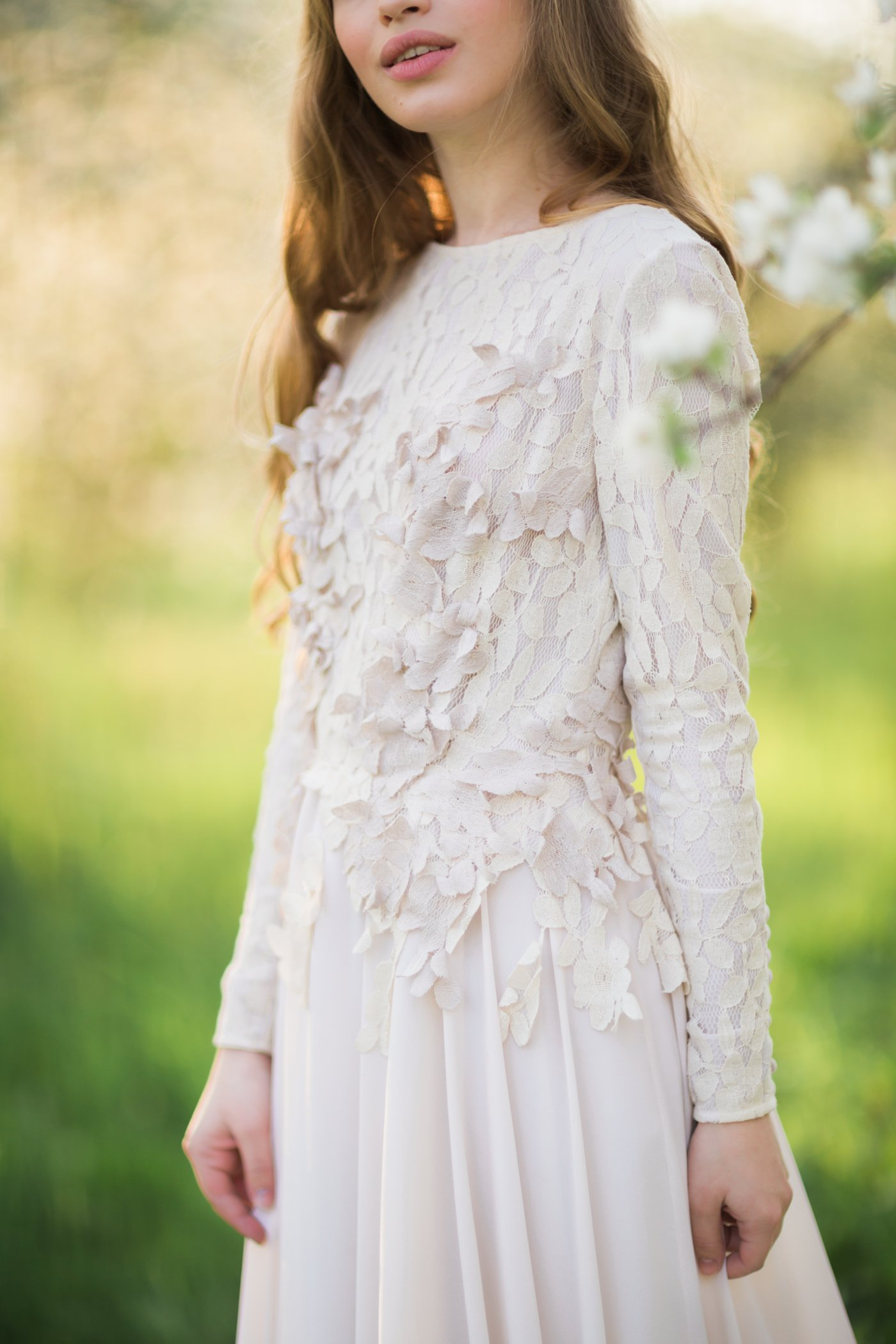 High Neck Wedding Dress With Long Sleeve And Lace Appliques Floating Down The Bodice