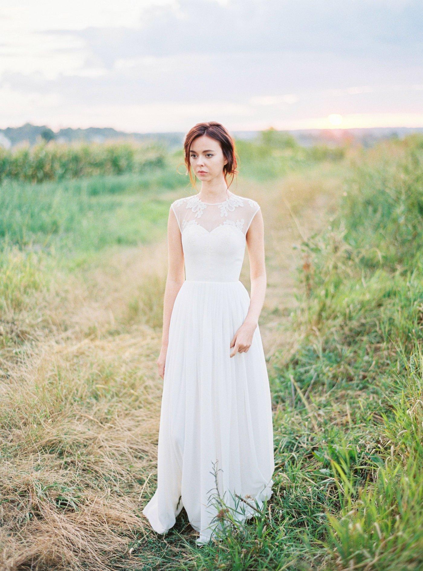 Off-white sleeveless wedding dress with embellished sheer bodice ...