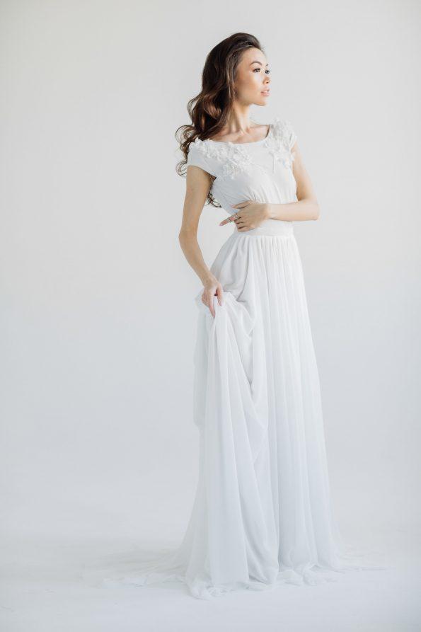 Cap sleeve wedding dress with open back
